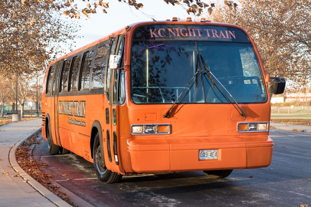 Orange Party Bus (Exterior, Front, Passenger Side)
